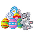 bunny resting beside easter eggs vector image vector image