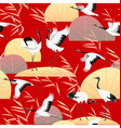 seamless pattern with japanese cranes and reed vector image
