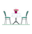 restaurant table with chairs and a bouquet vector image vector image