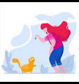 girl plays with a cat in a park on nature vector image vector image