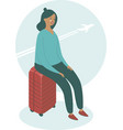 upset woman sitting on her suitcase vector image