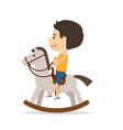 little boy sitting on horse toy vector image