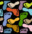 seamless pattern footprints in pastel colors vector image vector image