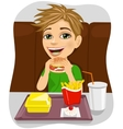 young boy eating cheeseburger with french fries vector image vector image