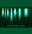 Set of green searchlights on a transparent
