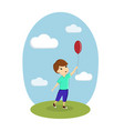 a boy is playing with a balloon on the street vector image vector image