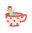cute little boy sitting in a cup kid have a fun vector image vector image