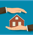 hand holding house real estate or safety concept vector image vector image