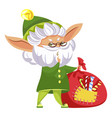 christmas elf holding bag with candies vector image vector image