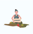 sad woman beggar holding sign board with hungry vector image vector image