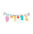 various items baby clothes on rope isolated