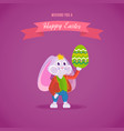 rabbit in clothes holding an easter egg in hand vector image vector image