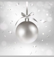 silver christmas ball and confetti vector image vector image