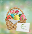 basket with easter eggs tulip and grass vector image