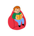 cute little boy sitting on a bag chair and reads a vector image