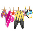 beach accessories hanging on a rope vector image vector image