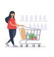 girl with a grocery cart makes purchases in shop vector image