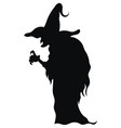 silhouette a witch in a hat black white vector image vector image
