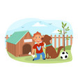 young boy playing with his pet dog outdoors vector image