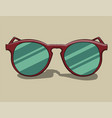 sunglasses in a red frame lie on a pale beige vector image