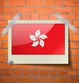 Flags Hong Kong scotch taped to a red brick wall vector image