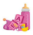 bamilk bottle with toys vector image vector image