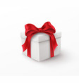 white gift box with red silk bow isolated on a vector image