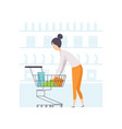 young woman putting products in shopping cart vector image vector image