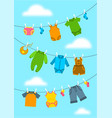 baby clothes hanging on ropes with clothespins vector image