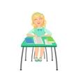 Schoolgirl Sitting Behind The Desk In School Class vector image vector image