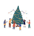 group friends decorating christmas tree vector image vector image