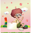 A boy holding an empty signage with flying candy vector image vector image