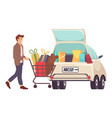 man with gift boxes in shopping cart young vector image
