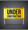 under construction banner on dark background vector image