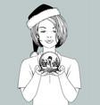 girl in santa hat holding a snow globe vector image vector image