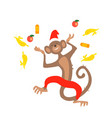 jumping christmas monkey with confetti fruit vector image