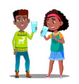 two afro american kids drinking organic milk from vector image vector image
