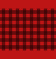 seamless pattern with black squares on a red vector image