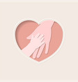 hands mother and baby in heart shaped paper