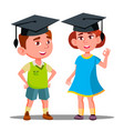 little boy and girl in large graduate cap vector image