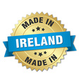 made in Ireland gold badge with blue ribbon vector image vector image