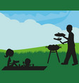 a family having a picnic vector image