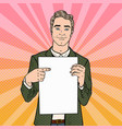 pop art businessman pointing at blank paper sheet vector image vector image