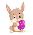 cartoon little bunny holding easter egg vector image