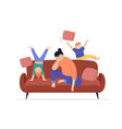 Tired mother sits on sofa children play jump and