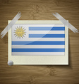 Flags Uruguay at frame on wooden texture vector image vector image