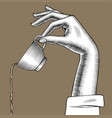female hand pours down a coffee from a cup vector image