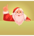 Santa Claus pointing up on a gold background vector image