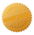 golden hand made award stamp vector image vector image