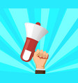 man holds a megaphone in hand vector image vector image